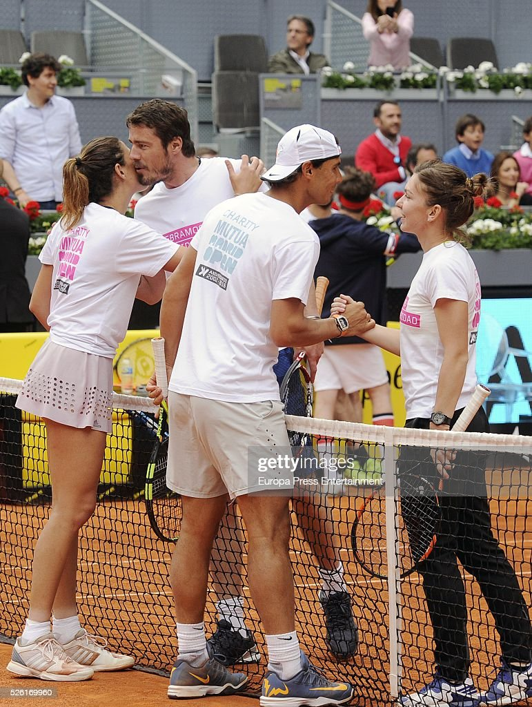 Rafa Nadal (2R) and Garbine Muguruza (L) attends Charity Day Tournament during Mutua Madrid Open at La Caja Magica on April 29, 2016 in Madrid, Spain.