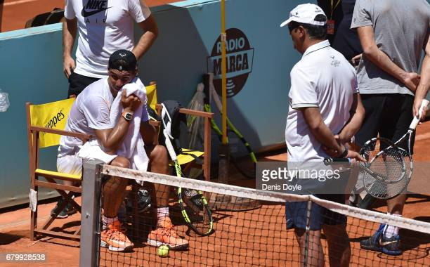Rafa Nadal listens to his coache Toni Nadal during a practice session during day two of the Mutua Madrid Open tennis at La Caja Magica on May 7 2017...