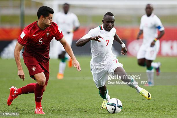 Rafa of Portugal and Ibrahima Wadji of Senegal battle for the ball during the FIFA U20 World Cup New Zealand 2015 Group C match between Portugal and...
