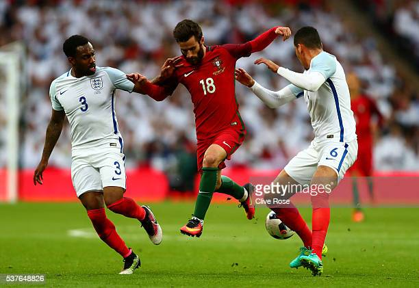 Rafa Silva of Portugal takes on Danny Rose and Chris Smalling of England during the international friendly match between England and Portugal at...