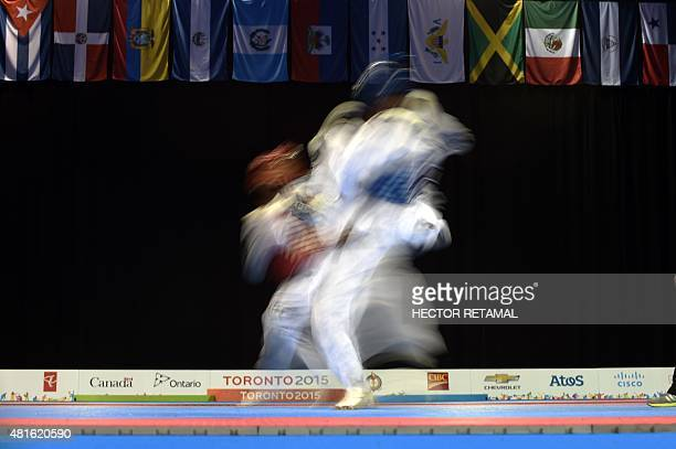 Rafael Alba of Cuba fights with Carlos Rivas of Venezuela in the Taekwondo Men's 80kg Gold Medal at the 2015 Pan American Games in Missassagua Canada...