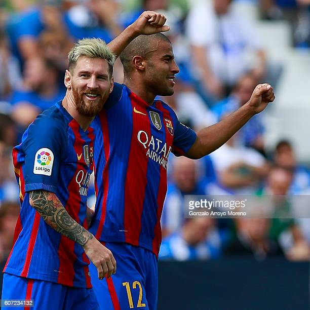 Rafael Alcantara alias Rafinha of FC Barcelona celebrates scoring their fifth goal with teammate Lionel Messi during the La Liga match between...