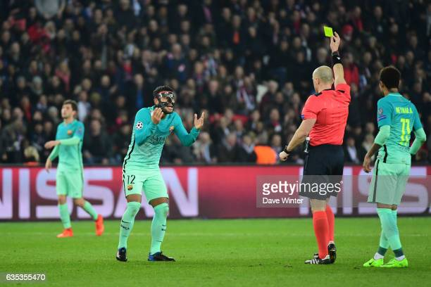 Rafael Alcantara Do Nascimento Rafinha of Barcelona receives a yellow card from referee Szymon Marciniak during the Champions League match between...