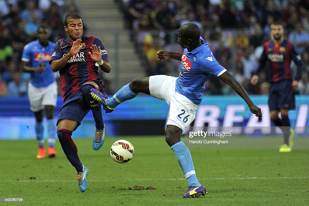 Rafael Alcantara of FC Barcelona and Kalidou Koulibaly of SSC Napoli in action during the pre-season friendly match between FC Barcelona and SSC Napoli on August 6, 2014 in Geneva, Switzerland.