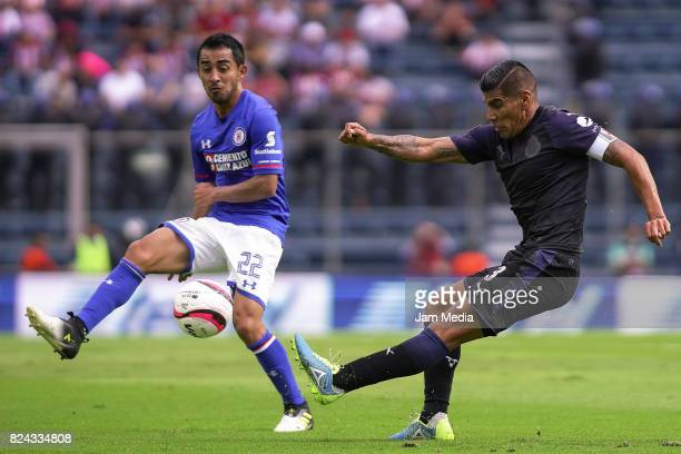 Rafael Baca of Cruz Azul tries to defend a shot by Carlos Salcido of Chivas during the 2nd round match between Cruz Azul and Chivas as part of the...