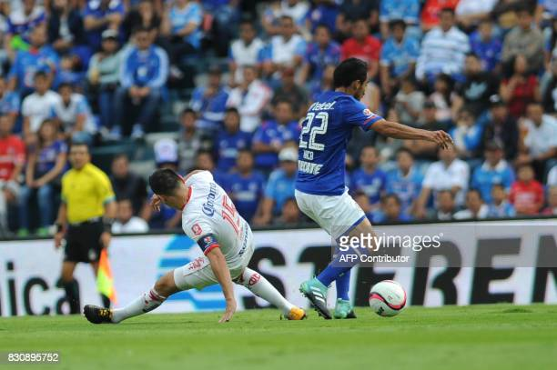 Rafael Baca of Cruz Azul vies for the ball with Antonio Rios of Toluca during their Mexican Torneo Apertura 2017 football match at Azul Stadium in...