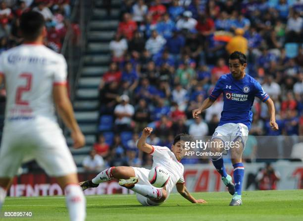 Rafael Baca of Cruz Azul vies for the ball with Martin Abundiz of Toluca during their Mexican Torneo Apertura 2017 football match at Azul Stadium in...