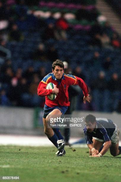 Rafael Bastide of Spain gets away from a tackle