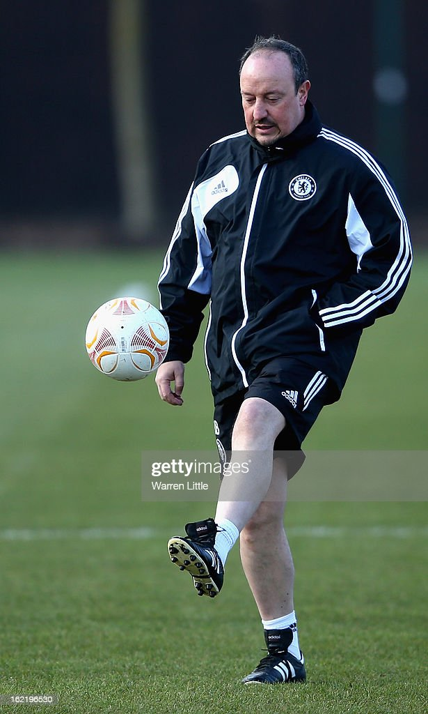Rafael Benitez, Interim First-Team Manager of Chelsea, kicks a ball around during a training session at Cobham training ground on February 20, 2013 in Cobham, England.