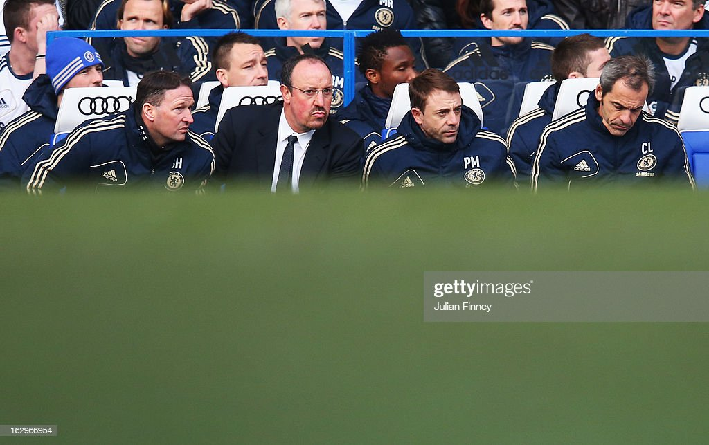 Rafael Benitez (2ndL), interim manager of Chelsea looks on with assistant coach Steve Holland (L), fitness coach Paco De Miguel and goalkeeper coach Christophe Lollichon (R) during the Barclays Premier League match between Chelsea and West Bromwich Albion at Stamford Bridge on March 2, 2013 in London, England.