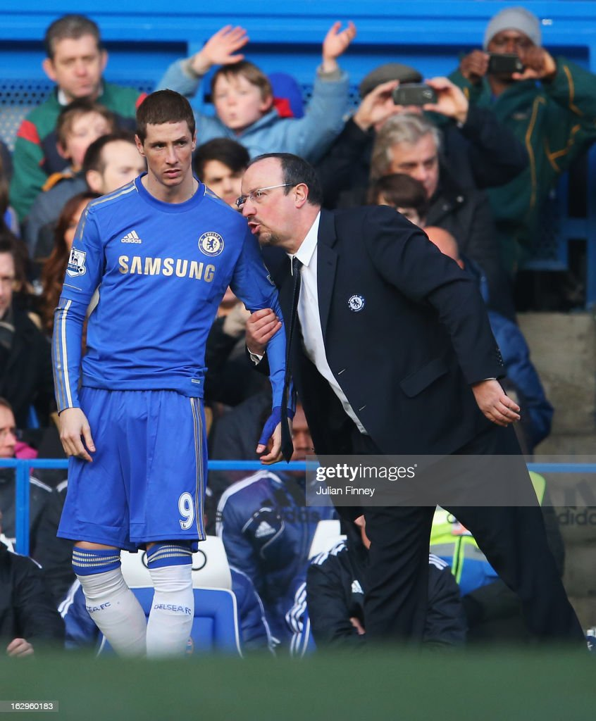 Rafael Benitez, interim manager of Chelsea talks to <a gi-track='captionPersonalityLinkClicked' href=/galleries/search?phrase=Fernando+Torres&family=editorial&specificpeople=194755 ng-click='$event.stopPropagation()'>Fernando Torres</a> as he prepares to come on as a substitute during the Barclays Premier League match between Chelsea and West Bromwich Albion at Stamford Bridge on March 2, 2013 in London, England.