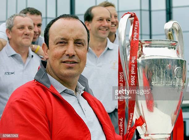 Rafael Benitez manager of Liverpool poses with the cup one day after winning the European Champions League final against AC Milan on May 26 2005 in...