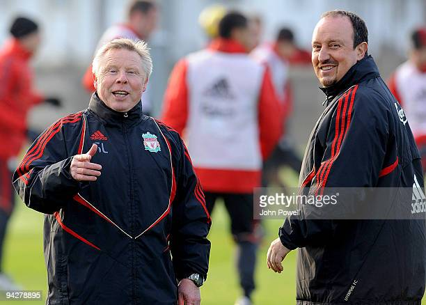 Rafael Benitez manager of Liverpool shares a joke with his assistant Sammy Lee during a team training session at Melwood training ground on December...