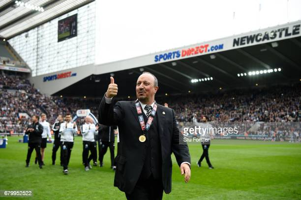 Rafael Benitez Manager of Newcastle United celebrates with his winners medal after the Sky Bet Championship match between Newcastle United and...