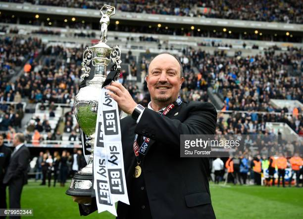 Rafael Benitez Manager of Newcastle United celebrates with the Championship trophy after the Sky Bet Championship match between Newcastle United and...