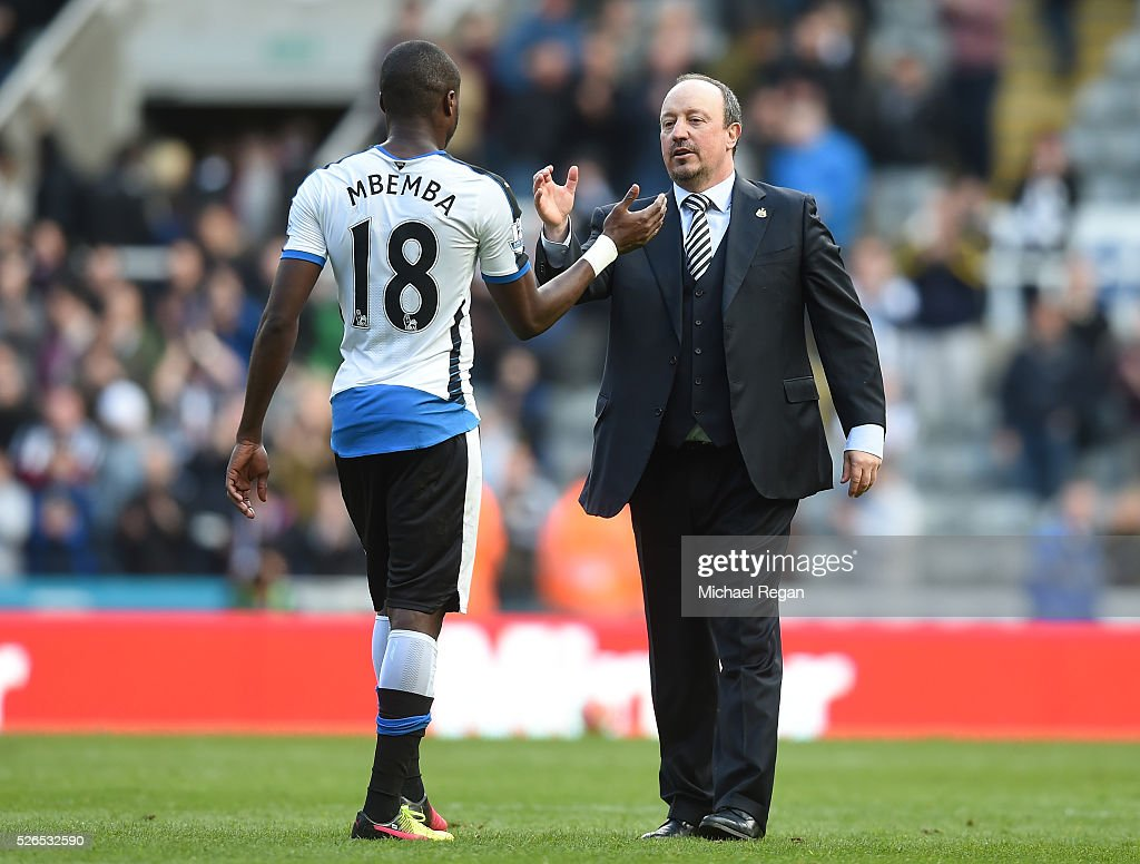 Rafael Benitez (R) manager of Newcastle United congratulates Chancel Mbemba (L) after their 1-0 win in the Barclays Premier League match between Newcastle United and Crystal Palace at St James' Park on April 30, 2016 in Newcastle upon Tyne, England.