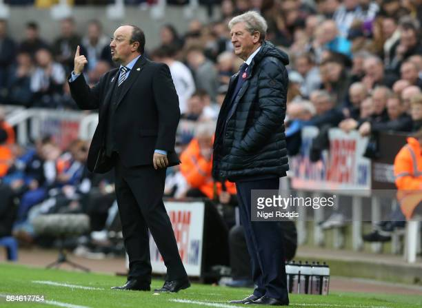Rafael Benitez Manager of Newcastle United gives instructions as Roy Hodgson Manager of Crystal Palace looks on during the Premier League match...