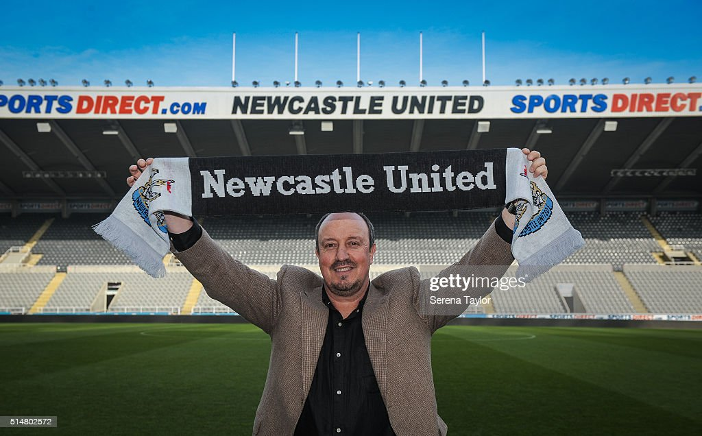 Rafael Benitez poses for photographs holding a club shirt pitch side after signing as Newcastle United's new manager at St.James' Park on March 11, 2016, in Newcastle upon Tyne, England.