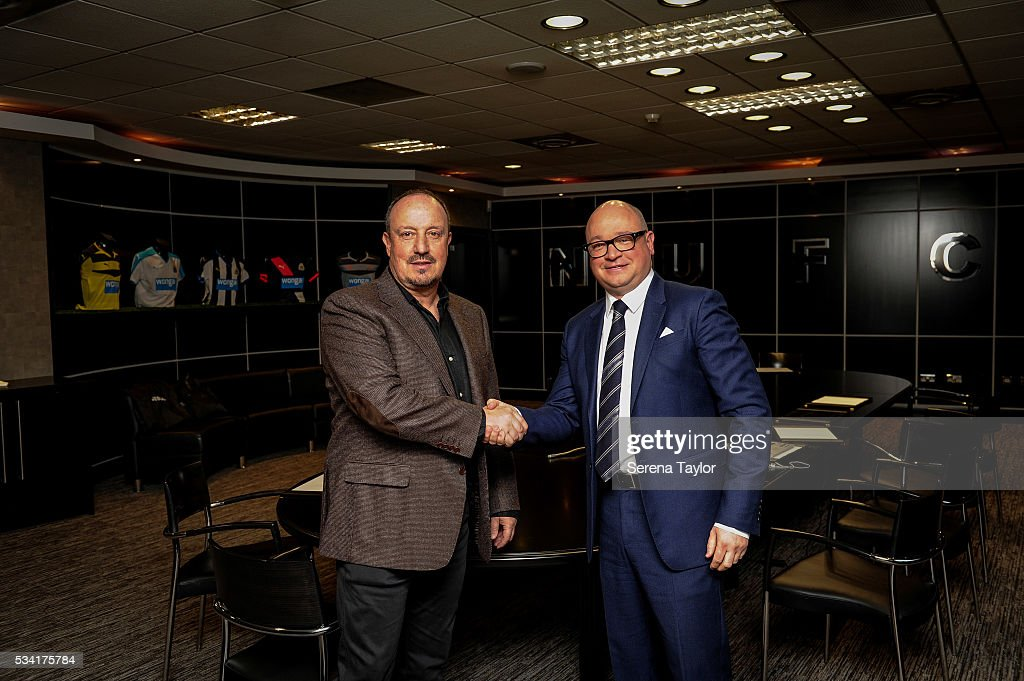 Rafael Benitez (L) signs a new contract as Newcastle United's manager with managing director Lee Charnley (R) at St.James' Park on May 25, 2016, in Newcastle upon Tyne, England.