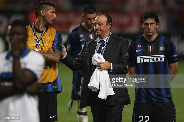 Rafael Benitez the Inter coach consoles Marco Materazzi as Diego Milito looks dejected after Inter's 02 defeat during the UEFA Super Cup match...