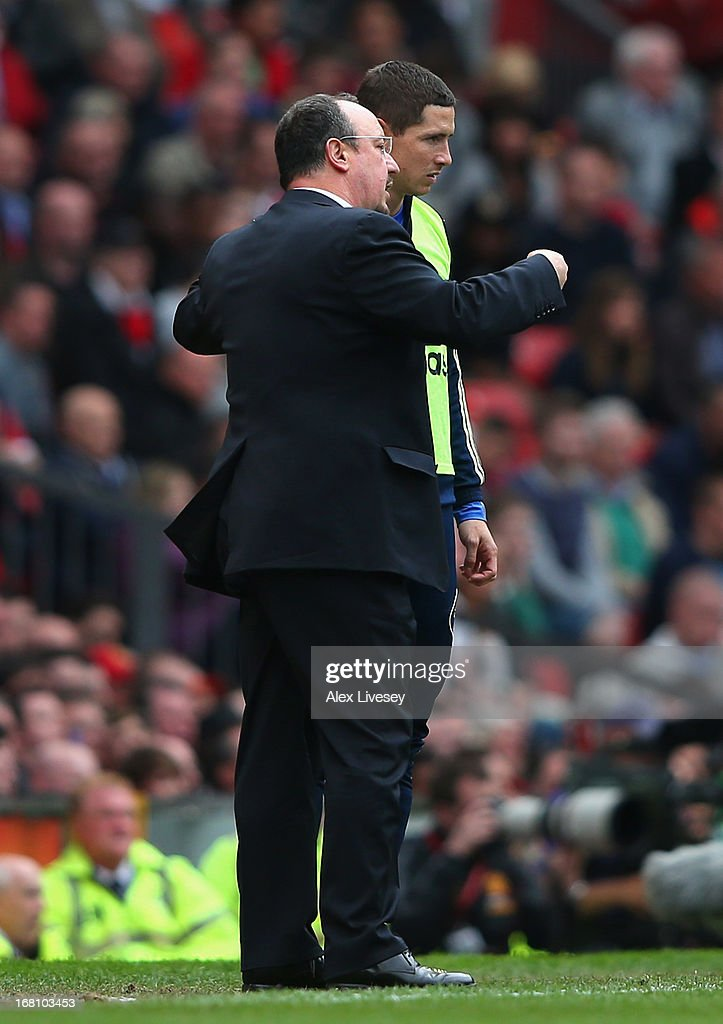 Rafael Benitez the interim manager of Chelsea talks with <a gi-track='captionPersonalityLinkClicked' href=/galleries/search?phrase=Fernando+Torres&family=editorial&specificpeople=194755 ng-click='$event.stopPropagation()'>Fernando Torres</a> prior to sending him on as substitute during the Barclays Premier League match between Manchester United and Chelsea at Old Trafford on May 5, 2013 in Manchester, England.