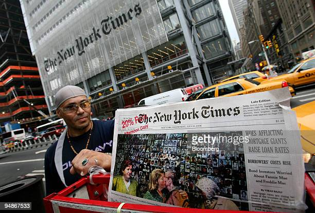 Rafael Bermudes of New York left looks over the news rack from which he sells the New York Times newspaper in New York US on Wednesday July 23 2008...
