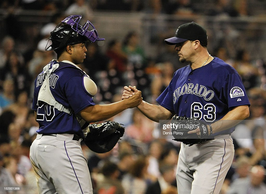<a gi-track='captionPersonalityLinkClicked' href=/galleries/search?phrase=Rafael+Betancourt&family=editorial&specificpeople=224728 ng-click='$event.stopPropagation()'>Rafael Betancourt</a> #63 of the Colorado Rockies is congratulated by <a gi-track='captionPersonalityLinkClicked' href=/galleries/search?phrase=Wilin+Rosario&family=editorial&specificpeople=5734314 ng-click='$event.stopPropagation()'>Wilin Rosario</a> #20 after getting the final out against the San Diego Padres at Petco Park on September 14, 2012 in San Diego, California. The Rockies won 7-4.