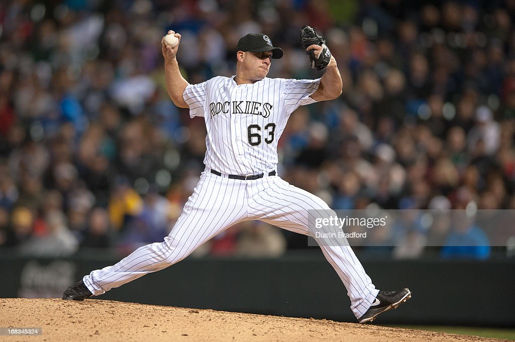 Rafael Betancourt #63 of the Colorado Rockies pitches in the ninth inning of a game against the New York Yankees at Coors Field on May 8, 2013 in Denver, Colorado. The Yankees beat the Rockies 3-2.
