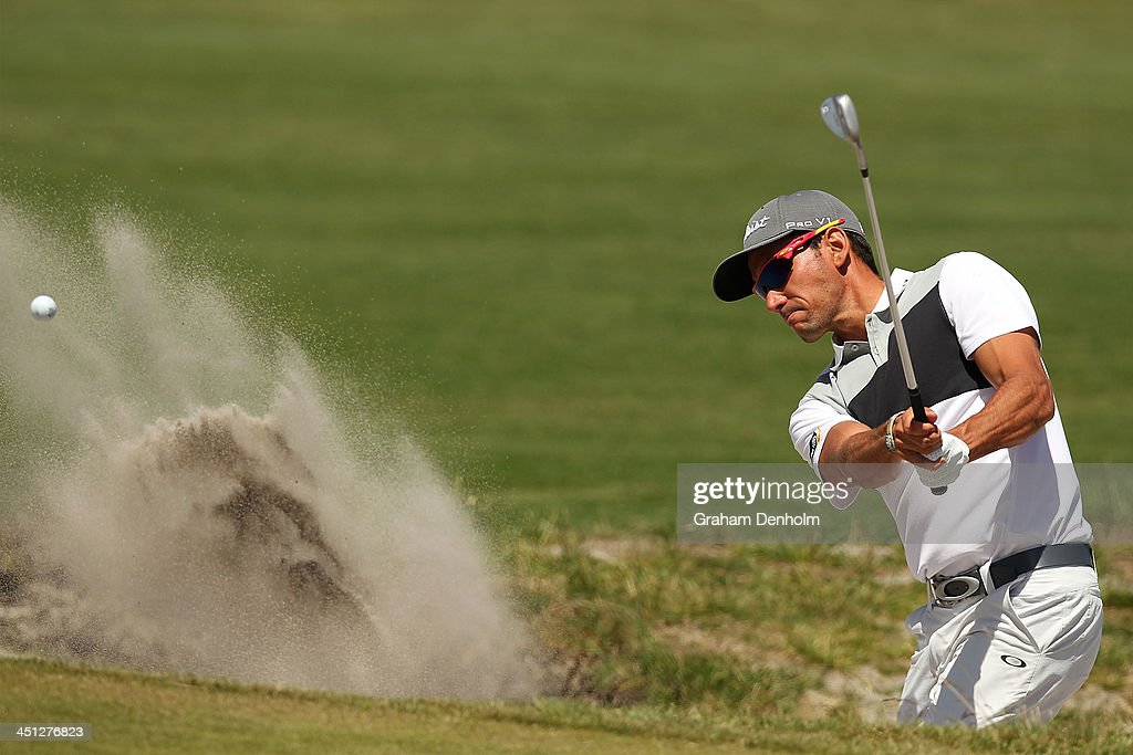 Rafael Cabrera Bello of Spain hits a shot from the bunker during day two of the World Cup of Golf at Royal Melbourne Golf Course on November 22 2013...