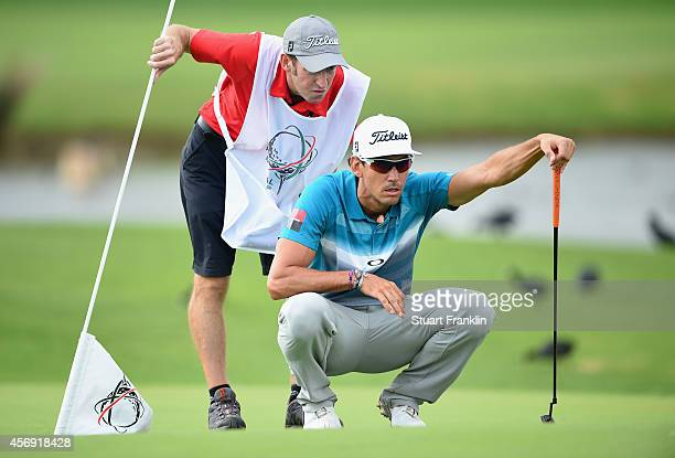 Rafael Cabrera Bello of Spain lines up a putt during the first round of the Portugal Masters at Oceanico Victoria Golf Club on October 9 2014 in...