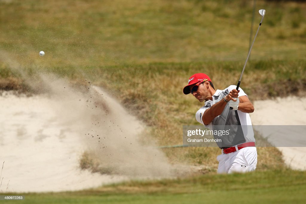 Rafael Cabrera Bello of Spain plays a shot from the bunker during day one of the World Cup of Golf at Royal Melbourne Golf Course on November 21, 2013 in Melbourne, Australia.