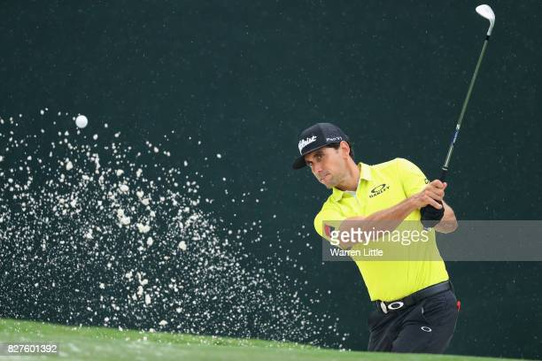Rafael Cabrera Bello of Spain plays his shot out of the bunker during a practice round prior to the 2017 PGA Championship at Quail Hollow Club on...