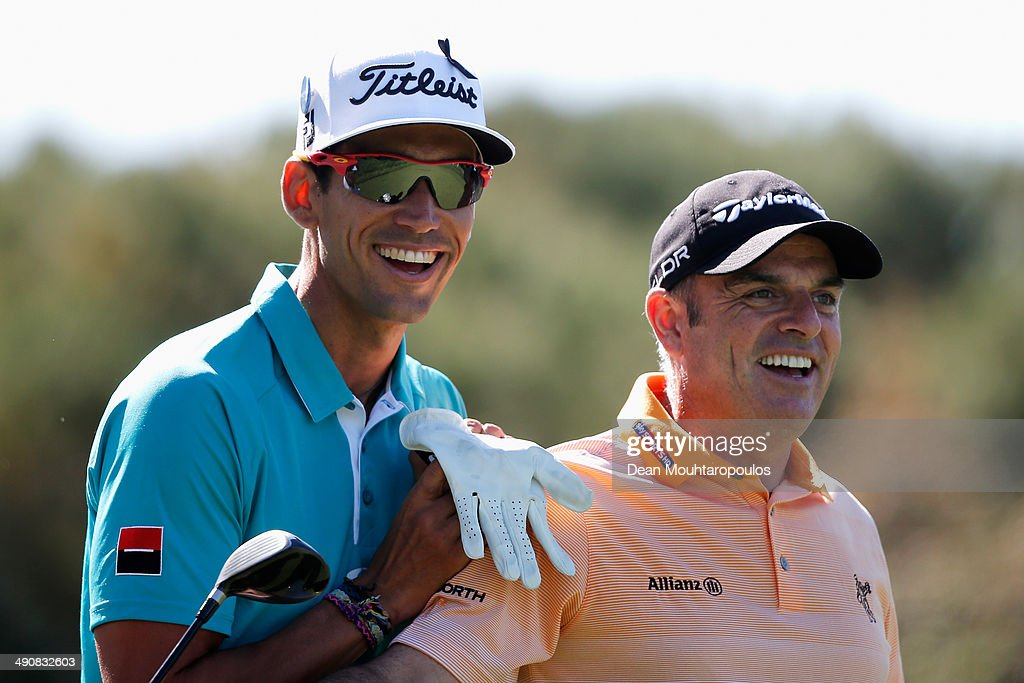 Rafael CabreraBello of Spain and Paul McGinley of Ireland share a joke and have a laugh on the 14th hole during Day 1 of the Open de Espana held at...