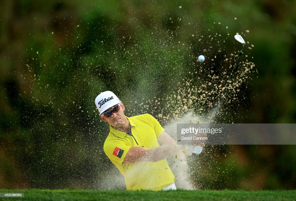<a gi-track='captionPersonalityLinkClicked' href=/galleries/search?phrase=Rafael+Cabrera-Bello&family=editorial&specificpeople=2747808 ng-click='$event.stopPropagation()'>Rafael Cabrera-Bello</a> of Spain hits his second shot from a greenside bunker on the third hole during the first round of the 96th PGA Championship at Valhalla Golf Club on August 7, 2014 in Louisville, Kentucky.