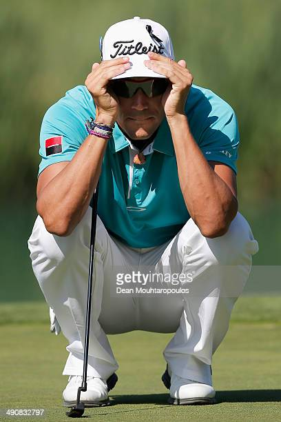 Rafael CabreraBello of Spain lines up a putt on the 13th green during Day 1 of the Open de Espana held at PGA Catalunya Resort on May 15 2014 in...