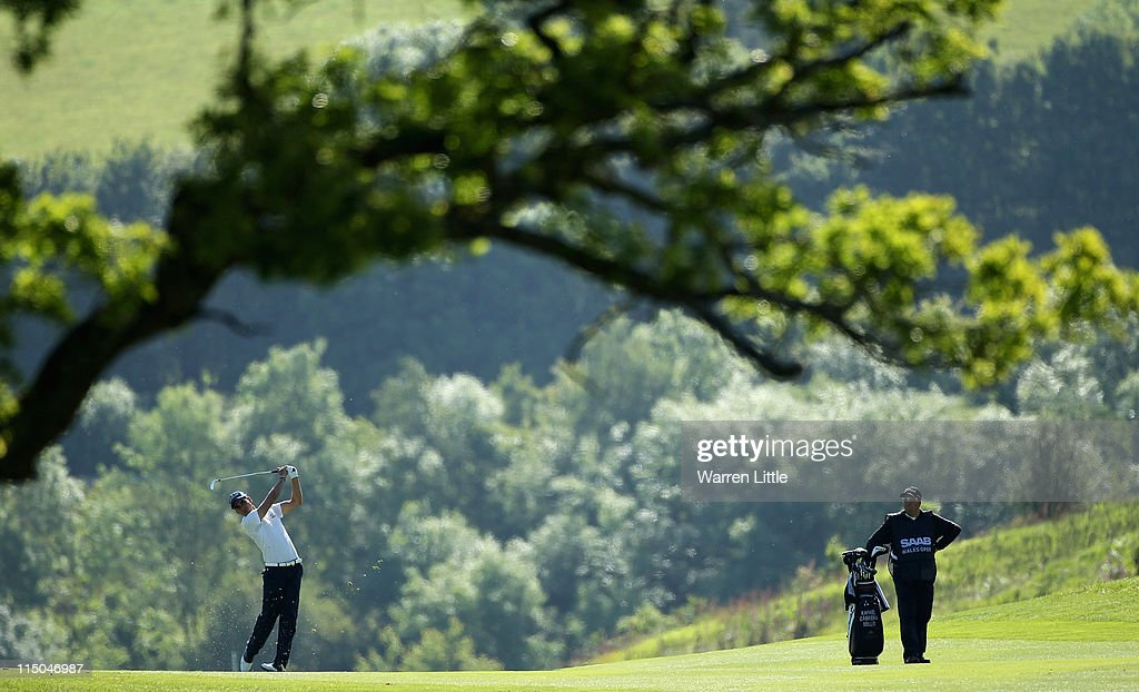 Rafael CabreraBello of Spain plays his second shot into the 16th green during the first round of the Saab Wales Open on the Twenty Ten course at the...