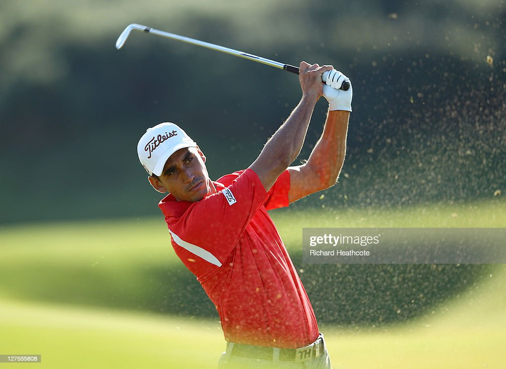 <a gi-track='captionPersonalityLinkClicked' href=/galleries/search?phrase=Rafael+Cabrera-Bello&family=editorial&specificpeople=2747808 ng-click='$event.stopPropagation()'>Rafael Cabrera-Bello</a> of Spain plays his second shot to the 17th green during the first round of The Alfred Dunhill Links Championship at the Kingsbarns Golf Links on September 29, 2011 in Kingsbarns, Scotland.