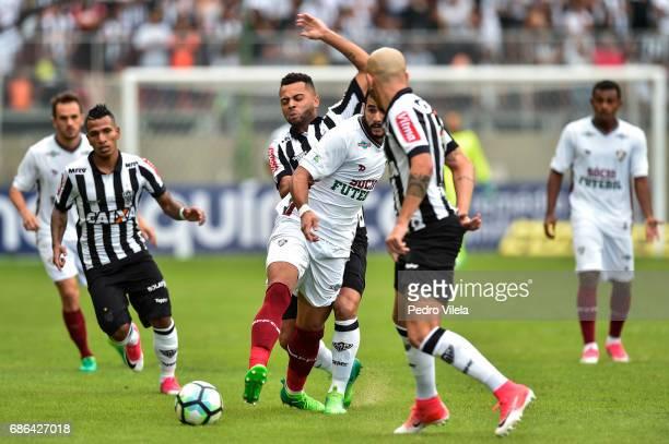 Rafael Carioca of Atletico MG and Henrique Dourado of Fluminense battle for the ball during a match between Atletico MG and Fluminense as part of...