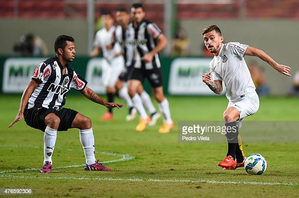Rafael Carioca of Atletico MG and Lucas Lima of Santos battle for the ball during a match between Atletico MG and Santos as part of Brasileirao...