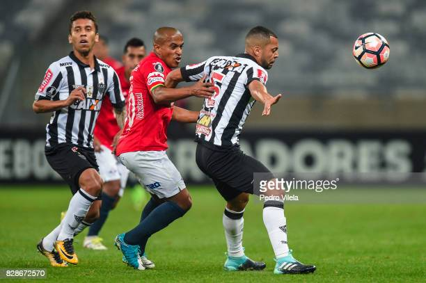 Rafael Carioca of Atletico MG and Serginho of Jorge Wilstermann battle for the ball during a match between Atletico MG and Jorge Wilstermann as part...