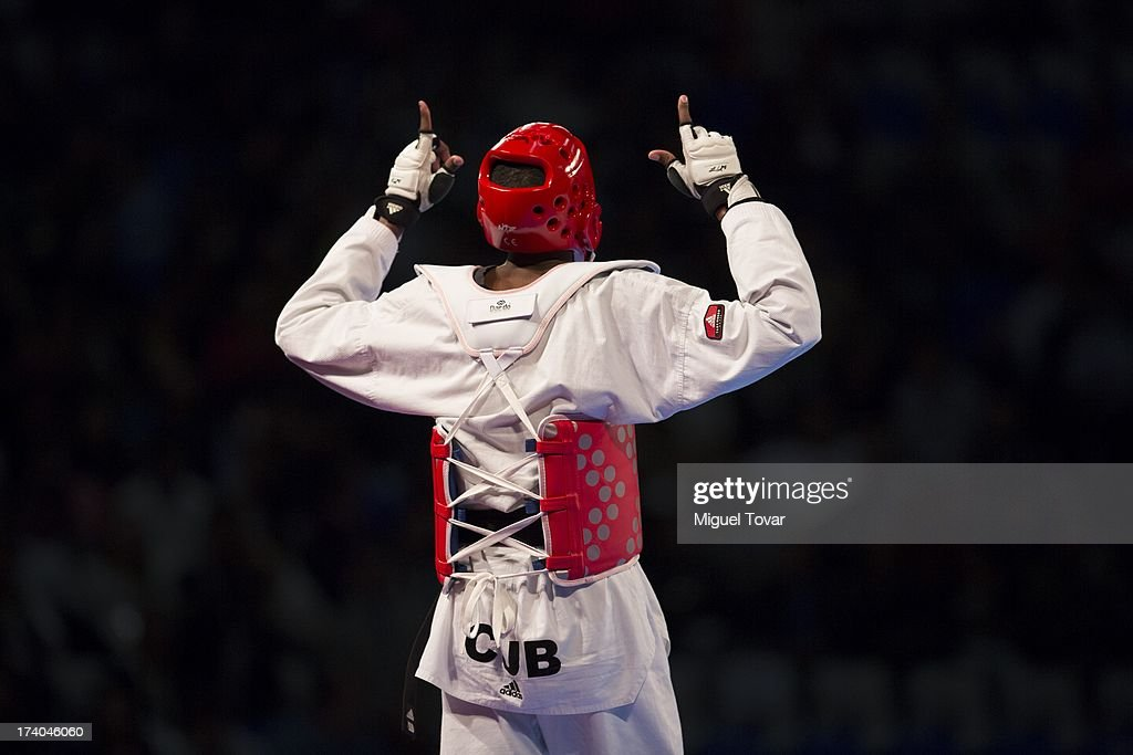 Rafael Castillo of Cuba celebrates after winning against Yassine Trabelsi of Tunisia during the -87 kg semifinal combat of WTF World Taekwondo Championships 2013 at the exhibitions Center on July 19, 2013 in Puebla, Mexico.