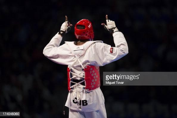 Rafael Castillo of Cuba celebrates after winning against Yassine Trabelsi of Tunisia during the 87 kg semifinal combat of WTF World Taekwondo...