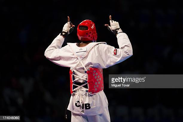 Rafael Castillo of Cuba celebrates after winning against Yassine Trabelsi of Tunisia during the 87 kg semifinal combat of WTF World Taekwondo...
