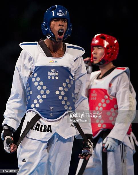 Rafael Castillo of Cuba celebrates after winning the gold medal against Mao Zhao Yong of China during the men's 87 kg final combat of WTF World...
