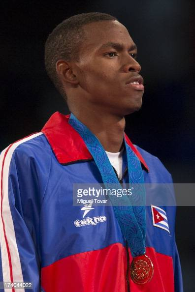 Rafael Castillo of Cuba receives the gold medal during the men's 87 kg final combat of WTF World Taekwondo Championships 2013 at the exhibitions...