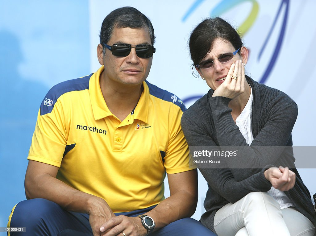 Rafael Correa, President of Ecuador, and his wife Anne Malherbe attend to see their daughter Sofia Correa participate in the opening day of Sport Climbing as part of XVII Bolivarian Games Trujillo 2013 at Villa Deportiva Regional del Callao on November 23, 2013 in Lima, Peru.