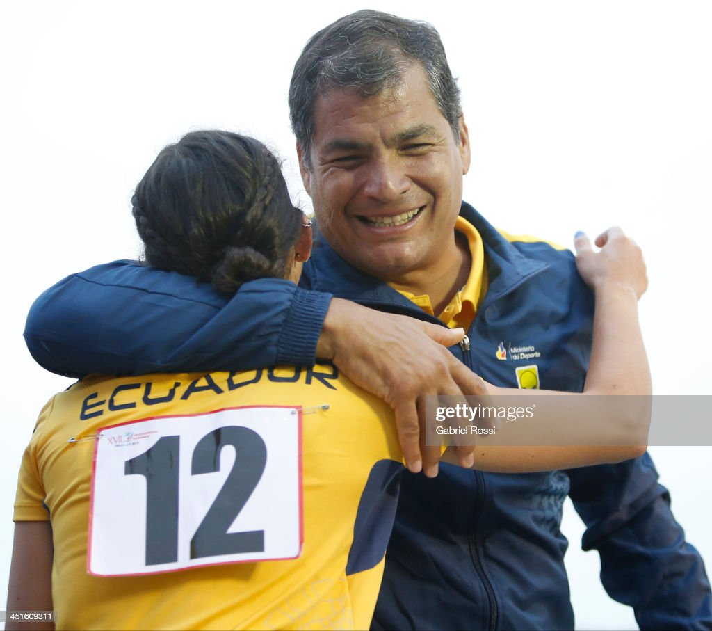 Rafael Correa, president of Ecuador greets Andrea Rosero of Ecuador after she won the silver medal in the opening day of Sport Climbing as part of XVII Bolivarian Games Trujillo 2013 at Villa Deportiva Regional del Callao on November 23, 2013 in Lima, Peru.