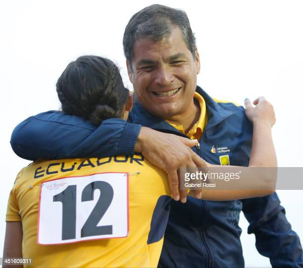 Rafael Correa president of Ecuador greets Andrea Rosero of Ecuador after she won the silver medal in the opening day of Sport Climbing as part of...