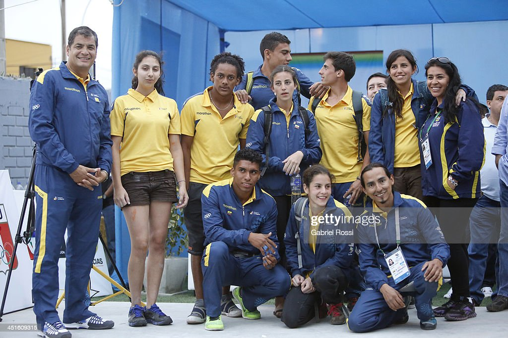 Rafael Correa, president of Ecuador poses with the Ecuadorean team in the opening day of Sport Climbing as part of the XVII Bolivarian Games Trujillo 2013 at Villa Deportiva Regional del Callao on November 23, 2013 in Lima, Peru.
