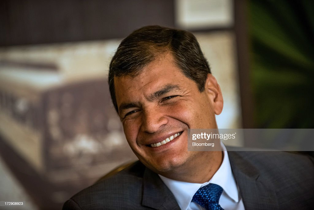 Rafael Correa, president of Ecuador, smiles during an interview in Portoviejo, Ecuador, on Saturday, June 29, 2013. Ecuador, the South American nation considering an asylum request from fugitive U.S. intelligence leaker Edward Snowden, renounced its U.S. trade benefits saying they were being used as 'blackmail.' Photographer: Meridith Kohut/Bloomberg via Getty Images